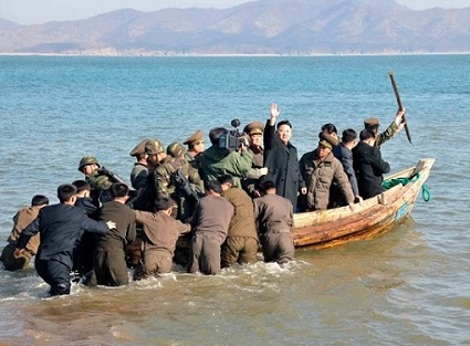 Kim Jong Un waves to shore as he leaves for America to deliver a death blow